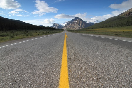 Empty road leading to the mountains photo