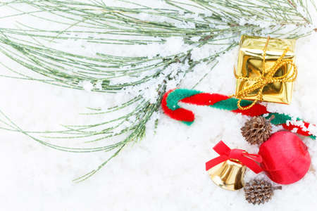 Christmas decoration on snow background.