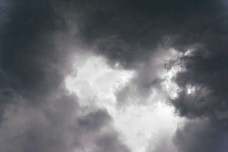 Dark rain cloud background before rain falling. Stock Photo