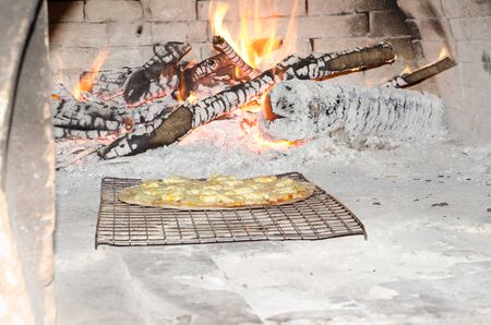 woodfired: Pizza cooking in a old oven