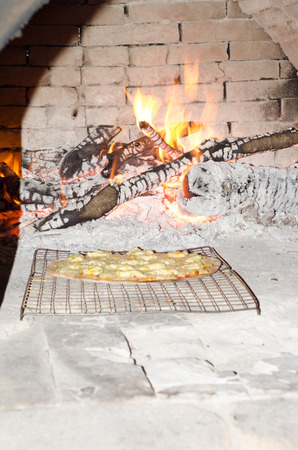 woodfire: Pizza cooking in a old oven