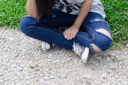 torn jeans: Torn jeans on young girl Stock Photo
