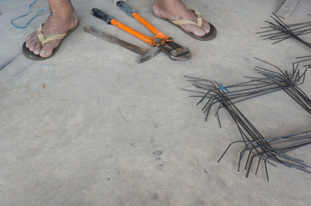 reinforce: Steel rods or bars used to reinforce concrete, in warehouse