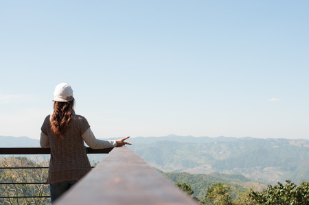 viewing: Beautiful young woman on the observation deck in Doi Wawee Chiangrai city Thailand