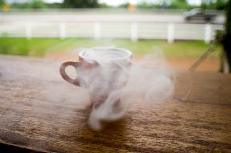 Hot glass with smoke on tebla Stock Photo