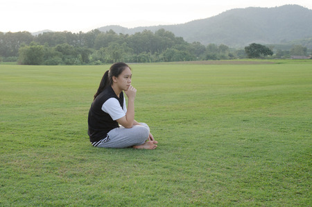 sitter: Young teenage girls sitting outside in a meadow  and on activities. Editorial