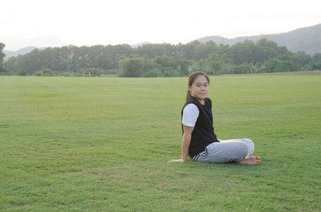 Young teenage girls sitting outside in a meadow  and on activities. Editorial