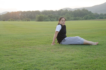 sitter: Young teenage girls sitting outside in a meadow  and on activities. Stock Photo