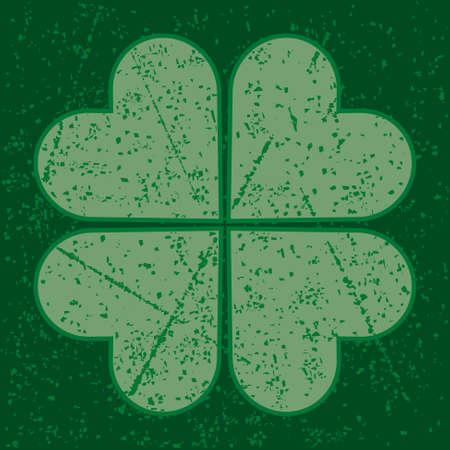shamrock: four leaf clover with grunge pattern on green background