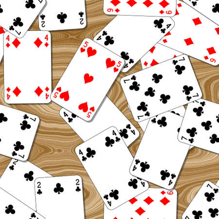 a lot of playing cards randomly scattered on the seamless woody table background - top view
