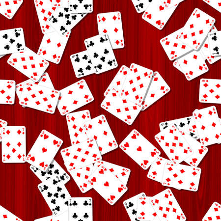 seamless pattern texture background - playing cards scattered on the red woody mahogany table