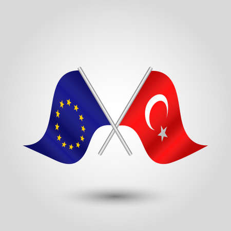 vector two crossed european union and turkish flags on silver sticks - symbol of eu and turkey