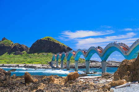 The curve bridge beyond the blue sea.it is famous view in taiwan.