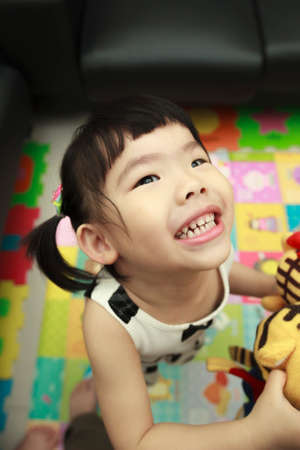 lively: living kid. she is very lively and active.