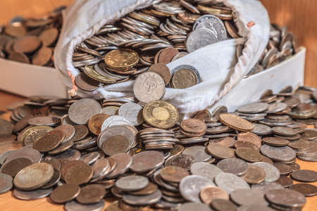 LOT OF MONEY IN BAG. Stock Photo