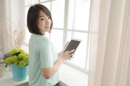 comfortable 20s girl reading book in indoor.