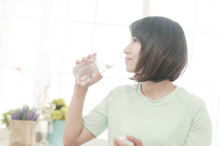 young girl drinking water everyday. Stock Photo