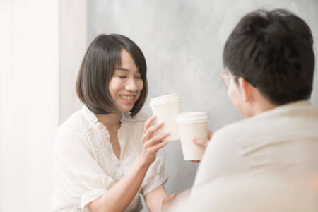 The girl is talking to a man. 版權商用圖片