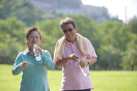 Retired people exercising in the park.
