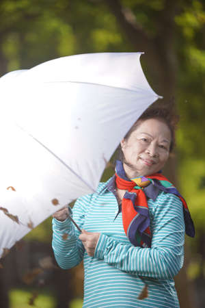 old lady holding an umbrella