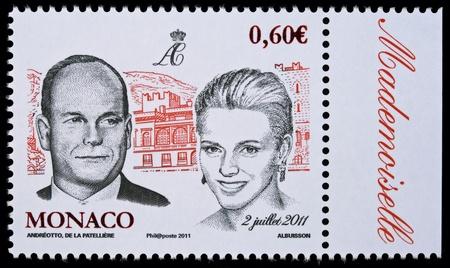 MONACO – CIRCA 2 JULY 2011: Postal stamp printed in Monaco showing Prince Albert II and Charlene Wittstock, circa 2 July 2011