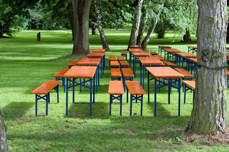 Beer tables and benches in a public park photo