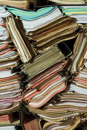 archiving: Stack of documents, papers and full binders