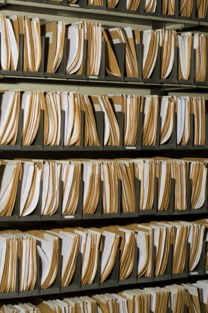 Shelf with file folders in a archives photo