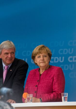 chancellor: SELIGENSTADT, GERMANY � AUGUST, 2013  Volker Bouffier, Prime Minister of Hessen, and German Federal Chancellor Angela Merkel made a election speech on August 14, 2013 in Seligenstadt, Germany
