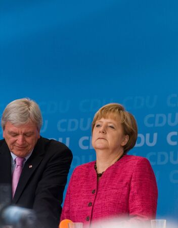 chancellor: SELIGENSTADT, GERMANY - AUGUST, 2013  Volker Bouffier, Prime Minister of Hessen, and German Federal Chancellor Angela Merkel made a election speech on August 14, 2013 in Seligenstadt, Germany