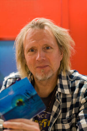 HEIDELBERG, GERMANY � FEBRUARY, 2014  Finnish guitarist Jyrki Muddy Manninen of the band Wishbone Ash at a autograph session for fans on February 18, 2014 in Heidelberg, Germany Stock Photo - 26097985