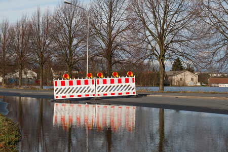 climatology: A road is closed because of flooding Stock Photo