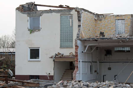 demolished house: Demolished house without roof, partly without exterior walls Stock Photo