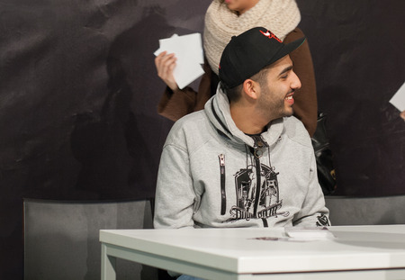 WEITERSTADT, GERMANY ? NOVEMBER, 2011: Rapper Fard (Farhad Nazarinejad) at a autograph session for fans on November 12, 2011 in Weiterstadt, Germany Editoriali