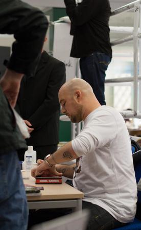 the autograph: WEITERSTADT, GERMANY ? NOVEMBER, 2011: Rapper Kool Savas (Savas Yurderi) at a autograph session for fans on November 15, 2011 in Weiterstadt, Germany