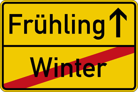 frhling: Season change. The German words for winter and spring (Winter and Fr?hling) on a road sign