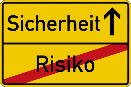 sicherheit: The German words for risk and safety (Risiko and Sicherheit) on a road sign Stock Photo