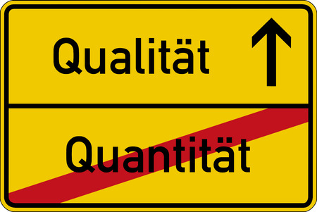 quantity: The German words for quantity and quality (Quantitaet and Qualitaet) on a road sign Stock Photo
