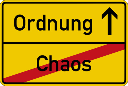 order chaos: The German words for chaos and order (Chaos and Ordnung) on a road sign