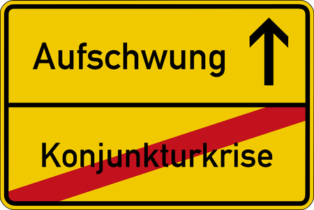 the stimulus: The German words for economic crisis and recovery (Konjunkturkrise and Aufschwung) on a road sign Stock Photo