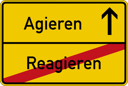 The German words for react and act (reagieren and agieren) on a road sign