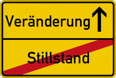 standstill: The German words for standstill and change Stillstand and Veraenderung on a road sign Stock Photo