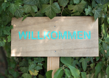 willkommen: Wooden sign with the german word for welcome Willkommen