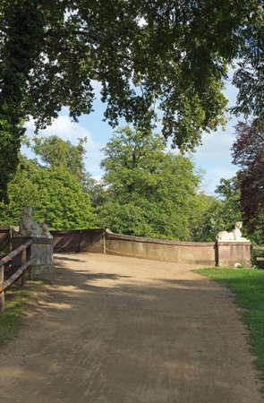 publicly: Red bridge in the park Schoenbusch near Aschaffenburg