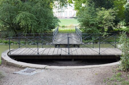 interruption: Swing bridge in park Schoennbusch near Aschaffenburg Stock Photo