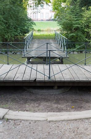 disconnection: Swing bridge in park Schoenbusch near Aschaffenburg