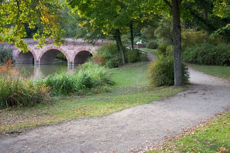 publicly: Red bridge in the publicly park Schoenbusch near Aschaffenburg Stock Photo