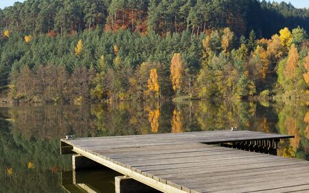 Lake with boat dock in the autumn
