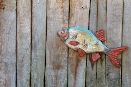 abstractly: Fish made of wood on wooden boards, background Stock Photo