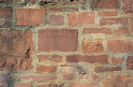precipitation: Flood mark that says flood in January 1982 (Hochwasser Januar 1982) in Aschaffenburg (Bavaria, Germany) on the Main
